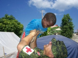 Martin, a military Physician Assistant  plays with children at the local orphanage.