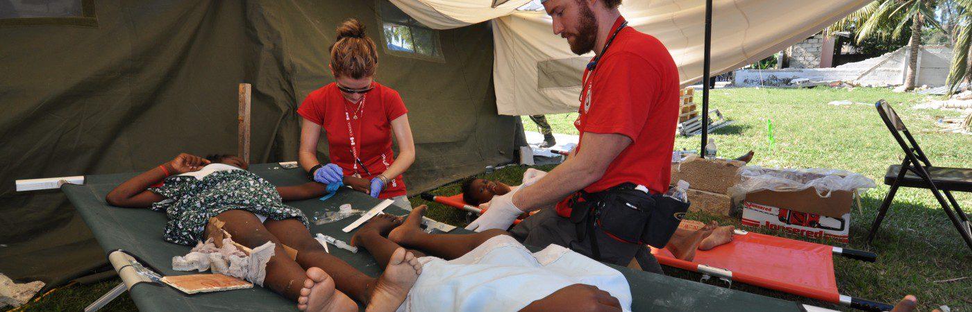 CMAT Nurses Aric Rankin and Maida Mrakovic treat children for dehydration in Haiti.