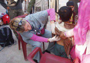 Dr. Lynda Redwood-Campbell assessing a child in a village near Muzaffarabad.