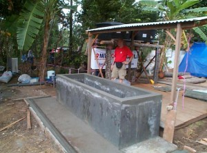 CMAT and its Reconstruction team worked with its partner, Mercy Malaysia in the field to build this water cistern which will provide safe water to hundreds of families in Aceh province. (January 2005)