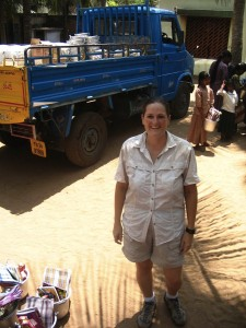 CMAT volunteer Tara Newell stands beside a truck delivering relief supplies to an orphanage in Tamil Nadu, India.