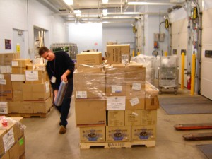 Ken Gilroy, Manager of Brantford General Hospital Stores, Brantford, Canada, helps shrink wrap a skid of medical supplies which will be shipped by air cargo to Sri Lanka by the weekend (December 30, 2004).