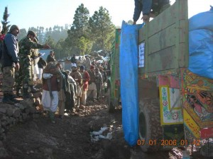 Distribution of tents in remote village outside of Muzaffarabad.