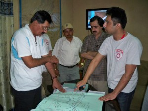 CMAT Assessment Team member Dr. Omar Elahi discusses transportation and logistics with local authorities in Sindh province, southern Pakistan.