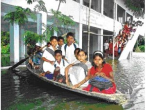 August 3, 2007: Students of Arakul Primary School use boats for transport to and from the school as floodwater has inundated the locality.