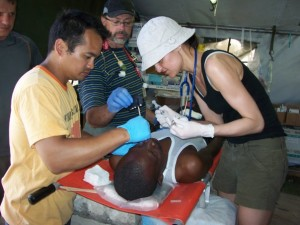 A patient receives treatment at the CMAT Field hospital in Leogane.
