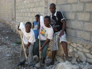 Young men are the muscle behind the clean up and reconstruction efforts in Haiti. Much of the rubble is being removed by hand.