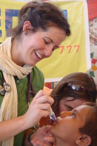 CMAT Team 2 - Dr. Katherine Smith administering medication to a young boy.