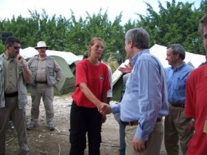 Kathy Harms briefs Canadian Prime Minister Stephen Harper on CMAT medical relief activities in Haiti.