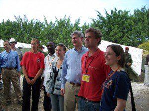 Team Leader Kathy Harms briefs Prime Minister Stephen Harper at Leogane camp, Haiti