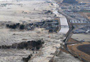 The quake unleashed a tsunami that swept boats, cars, buildings and tonnes of debris kilometres inland. Here the tsunami strikes shores along Iwanuma. (Photo courtesy Kyodo News/AP)