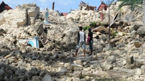 Residents view the ruins of the historic Holy Cross Parish Church in Maribojoc on the central Philippine island of Bohol on Friday, October 18. The death toll has risen above 180 after a magnitude-7.1 earthquake on October 15. (AP Photo)
