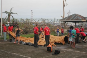 CMAT Team sets up the field hospital tent on a tennis court near the Ormoc City Hall.