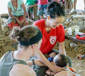 CMAT Nurses conduct a well-baby check up in Baluwa, Nepal.